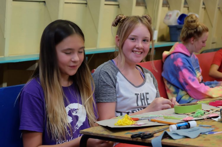3 girls doing crafts in the Craft Hall.