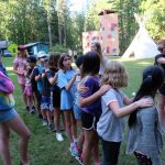 campers trying out trust activities together before low ropes.